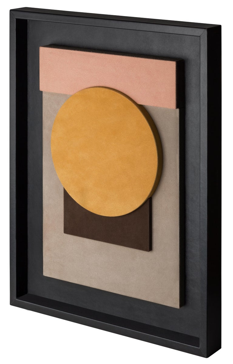 This suede-covered wall sculpture is framed in black nappa.