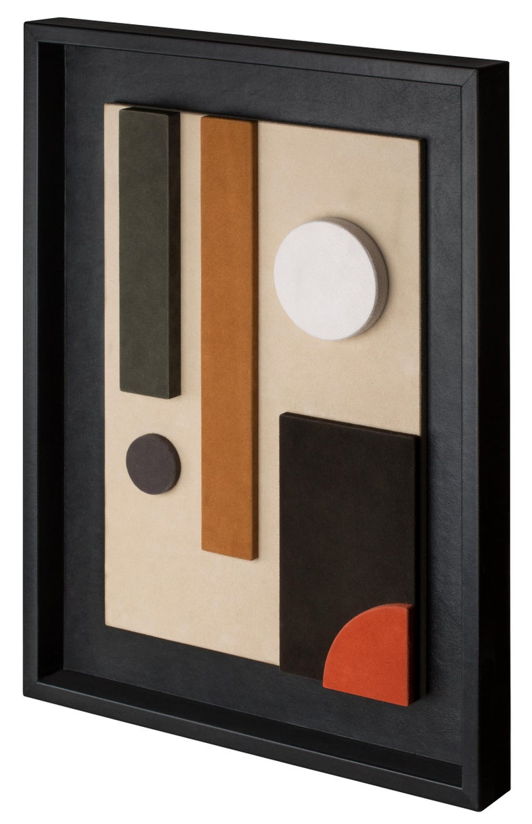 This suede-covered wall sculpture is framed in black nappa. The interaction between colors and shapes makes it a decorative piece based on pure geometry, where abstraction and figuration create formal structures that allow color to dominate. This