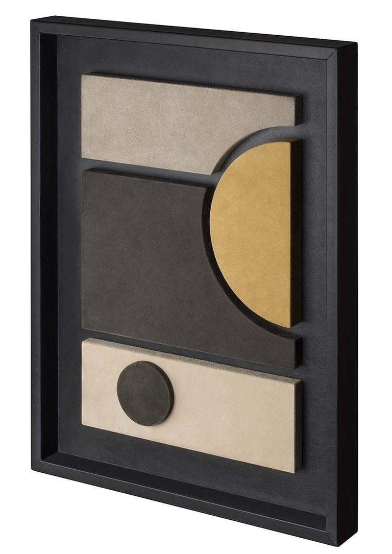 A stunning example of modern abstract art, this superb wall sculpture blurs the lines between abstraction and figuration to create a bold work of art. Dominated by sleek lines and colors, basic forms are covered in a soft suede, with an orange