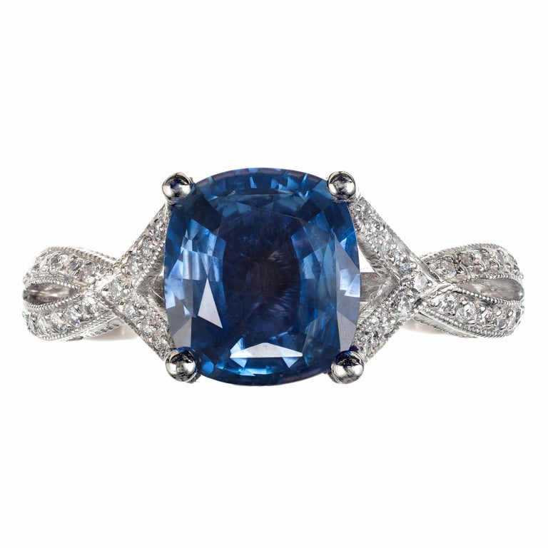 Tacori sapphire and diamond engagement ring. Bright cushion cut all-natural periwinkle blue sapphire set in a platinum setting with 74 round accent diamonds.   1 cushion cut blue sapphire, Approximate 2.07cts GIA Certificate # 2175170341 74 round