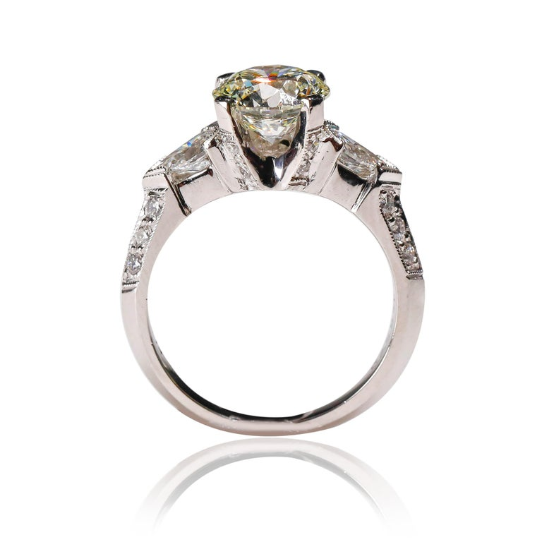 Tacori Platinum 3 Carat Round Pear Shape Diamond Wedding Ring  Luxurious in every way, this ring is a stunning example of how you should feel wearing it. Features 0.83 ct shimmering diamonds aligned together in 2.17 TCW of a center diamond in