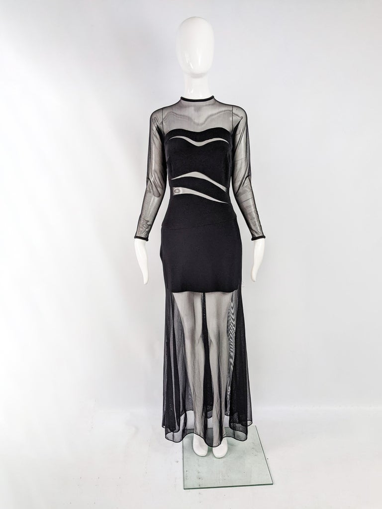 A stunning vintage long sleeve evening gown from the 90s by luxury American- Japanese fashion designer, Tadashi Shoji. In a black bandage material with cut outs and a sheer mesh overlay.   Size: Marked L but measures like a UK 10-12/ US 6-8. Please
