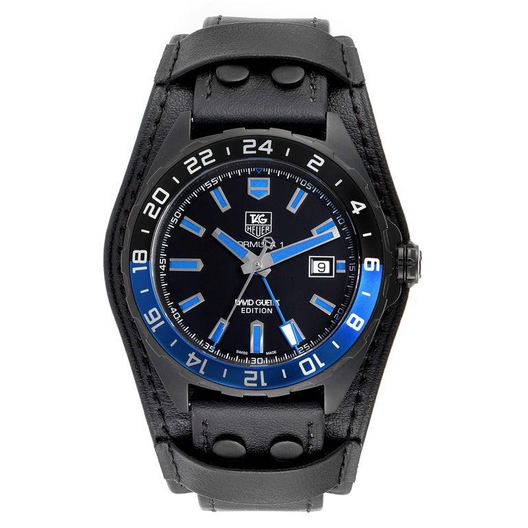 Tag Heuer Formula 1 GMT David Guetta Titanium PVD Batman Watch WAZ201A. Automatic self-winding movement. Titanium PVD coated case 43.0 mm. Uni-directional rotating black and blue (batman) aluminum bezel with 24 hour GMT indicated by the blue arrow.