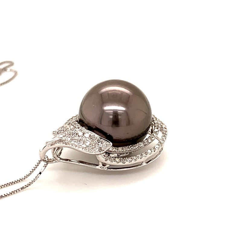 Elegant Tahitian pearl diamond pendant. Very good luster, black with pink, silver overtone, 14.7mm round Tahitian pearl, surrounded with two rows of round brilliant cut diamonds. Handcrafted design set in high polished 18 karat white gold, along
