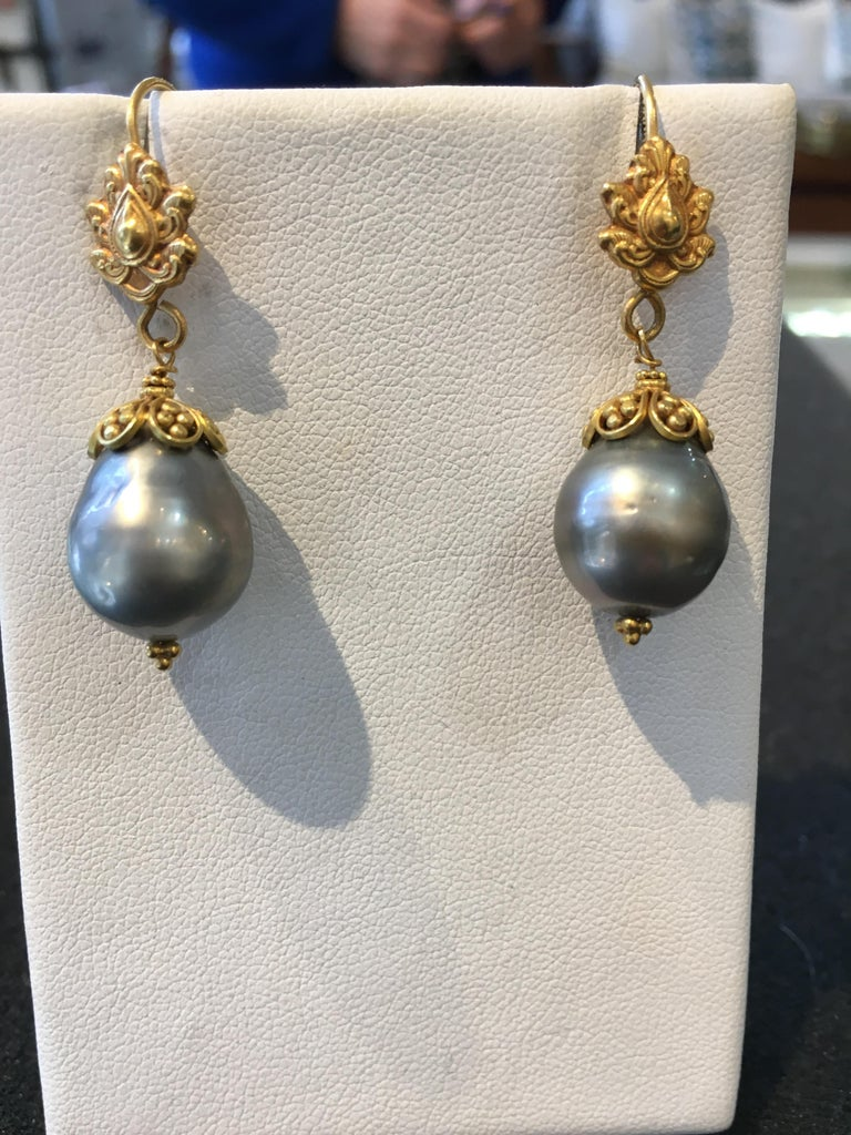 Pair of 22K gold and pear-shaped Tahitian pearl drop earrings.  On a French wire for pierced ears.  Pearls measure 12mm.  Fine hand tooling and granulation work to the high karat gold.  By Deborah Lockhart Phillips