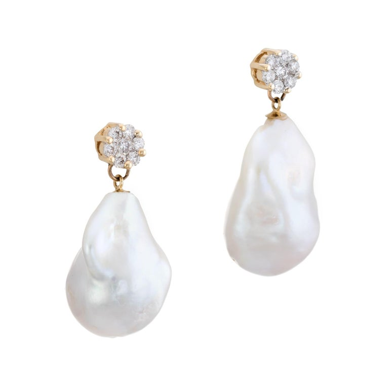 Elegant pair of Tahitian baroque pearl & diamond earrings, crafted in 14k yellow gold.   Large irregular shaped Tahitian South Sea baroque pearls measure 22mm x 14mm and 20mm x 13.5mm. The pearls exhibit excellent luster with a rose overtone. Round