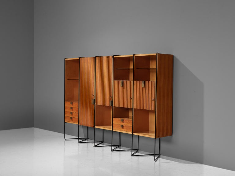 Taichiro Nakai, cabinet, metal, glass, brass, maple, mahogany, Italy, 1953.  This cabinet by Nakai consists of five compartments, supported by a metal frame that has a zig-zag structure. The warm tone of the mahogany and maple builds a striking