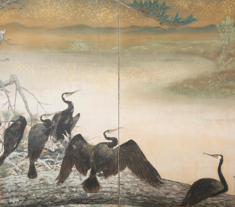 An exquisite Taisho period screen depicting nesting cormorants painted on raw silk with gold fleck by Japanese artist Asami Joujou (b. 1890 in Himeiji, Japan-d. 1974), circa 1912-1926.