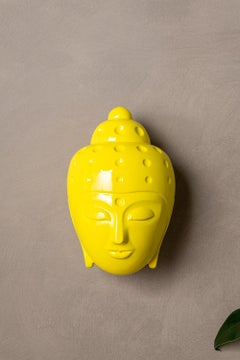 Contemporary buddha head sculpture - painted in yellow car paint