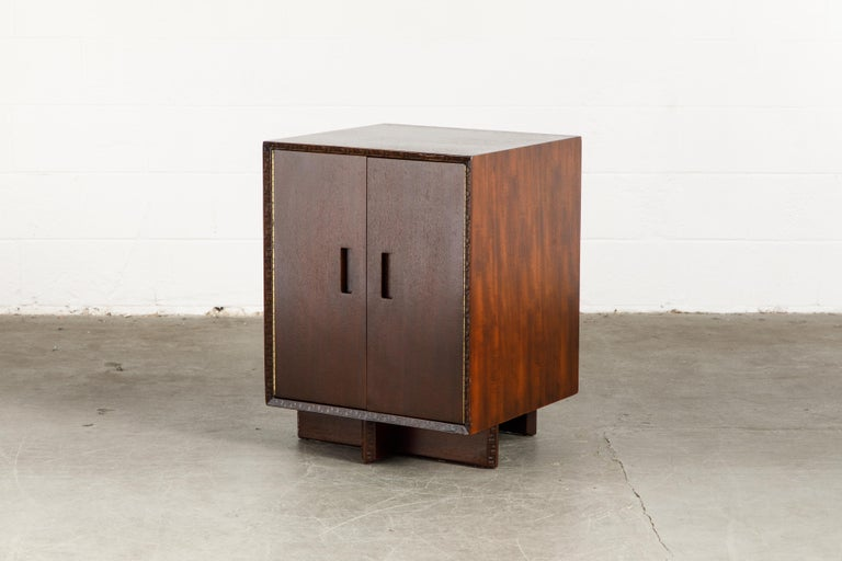 This gorgeously refinished Honduran Mahogany 'Taliesin' cabinet was designed by Frank Lloyd Wright for Heritage-Henredon in 1955 and produced only for two years, therefore are now highly sought-after and rare collectors items. This example is signed