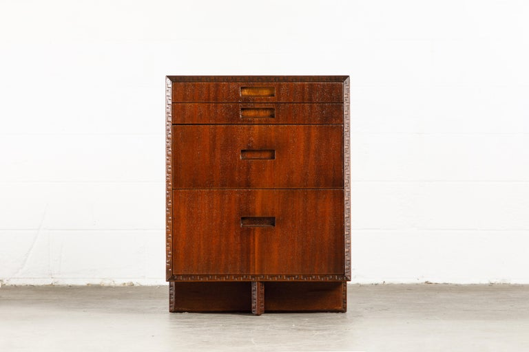 This pair of gorgeously refinished Honduran Mahogany 'Taliesin' cabinets were designed by Frank Lloyd Wright for Heritage-Henredon in 1955 and produced only for two years, therefore are now highly sought-after and rare collectors items. These