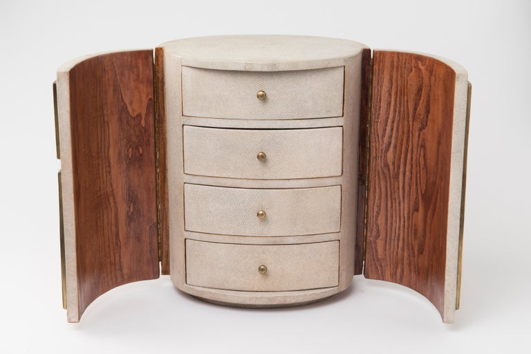 Talisa jewelry chest in cream shagreen, black pen shell and brass by R&Y Augousti is a stunning piece to store your personal items. This piece has 2 doors that open to 4 drawer compartments that have black velvet trays. See images at end of slide of