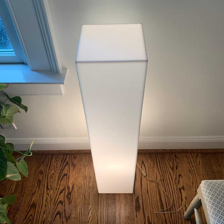 Tall modernist white Lucite or acrylic pedestal stand display column Pedestal is electrified and lights up using a LED light bulb.