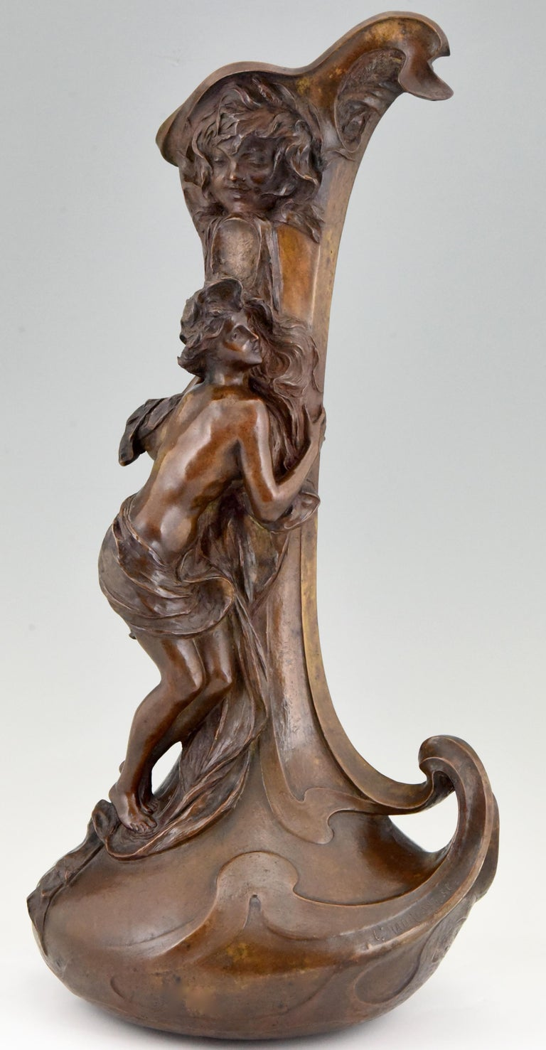 """Important and rare bronze Art Nouveau vase picturing a semi nude lady at a fountain signed by Lucas Madrassi (1848-1919) marked cire perdue, cast in lost wax technique. Beautiful rich brown patina.   Literature: Etains 1900"""" Philippe Dahan, les"""