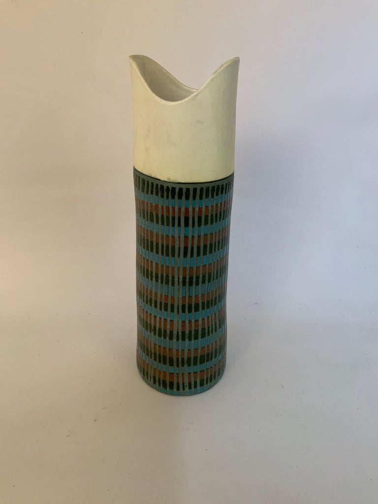 Tall Bitossi Italian pottery vase, circa 1950-1960. Signed on the bottom, Italy, 849. Egg shell white 'V' cut opening. Terracotta, turquoise, black ring decoration streaked with gray. Very good condition with no visible chips, cracks, crazing,