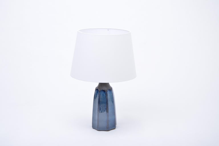 Tall Blue Stoneware Table Lamp Model 1042 by Einar Johansen for Søholm  Table lamp made of stoneware with blue ceramic glazing to the base of the lamp. Designed by Einar Johansen and produced by Danish company Soholm. The lamp has been rewired for