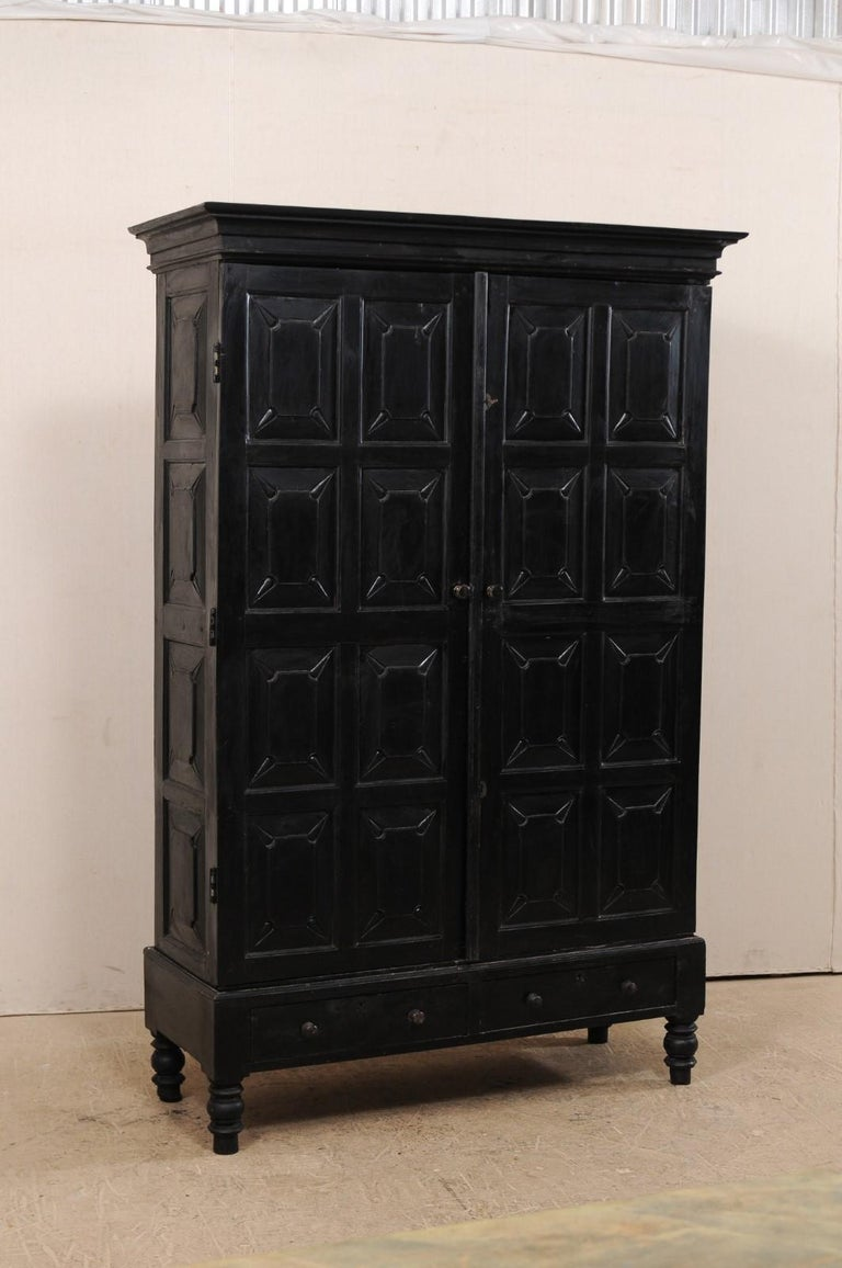 Tall British Colonial Carved Wood Storage Cabinet From The