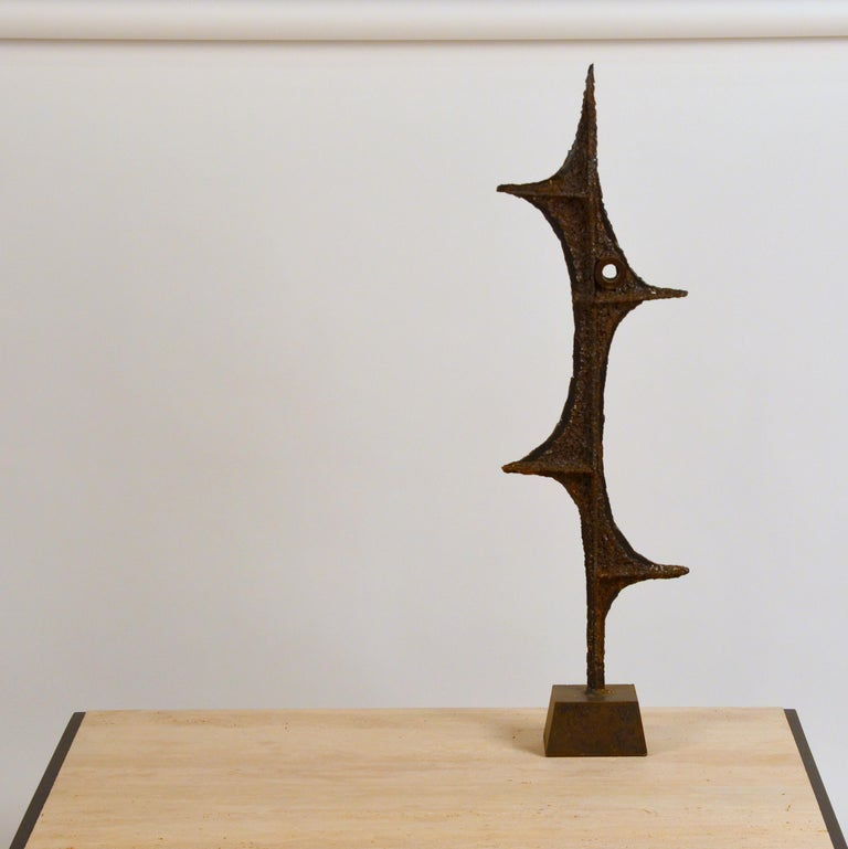 Tall Brutalist studio sculpture by John De La Rosa. Signed.  The last image shows a similar sculpture in an interior setting, for inspiration.