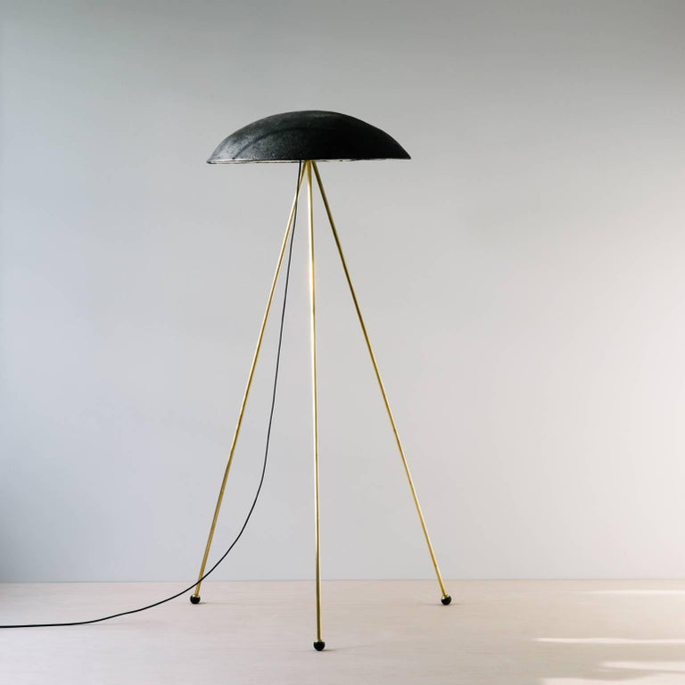 The Tall Buddy Floor Lamp is more staid than the funny buddy with an unmoving