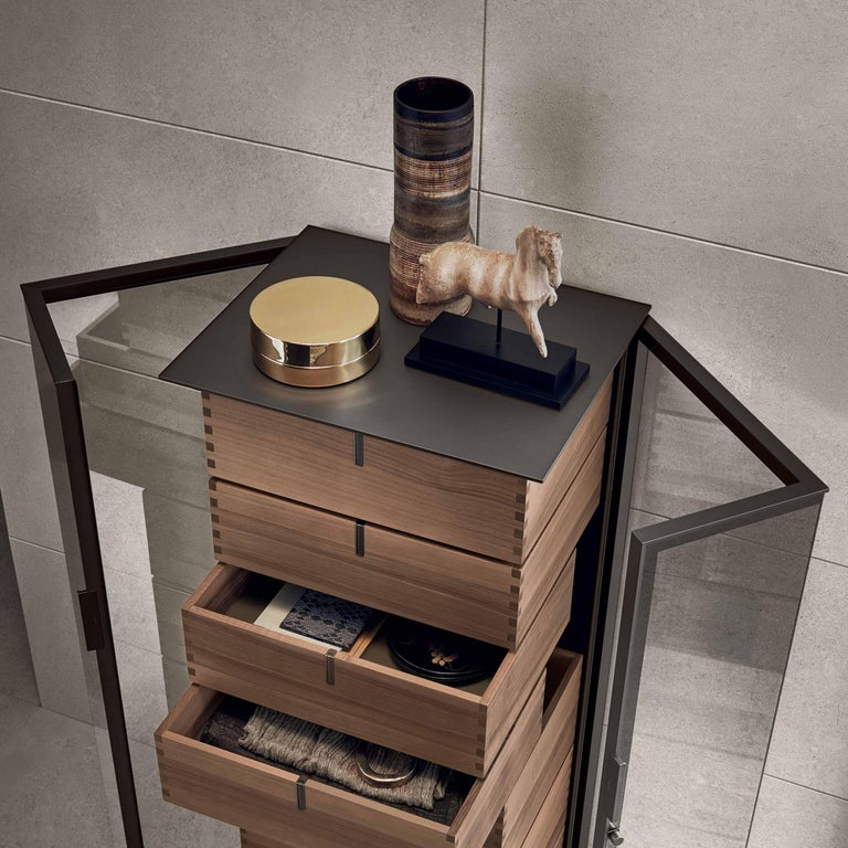 The Ala cabinet designed by Giuseppe Bavuso for Rimadesio is made with walnut veneered drawers characterized by traditional