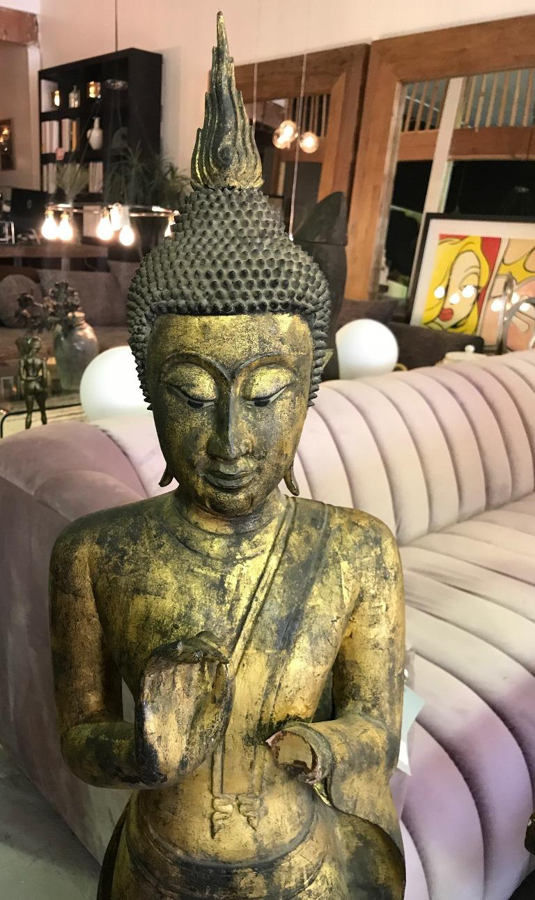 Tall hand carved wooden standing Buddha on display stand. Likely Thai. Beautifully carved and detailed.   Great addition to any collection or eye-catching accent piece to any standing.   Dimensions: 54