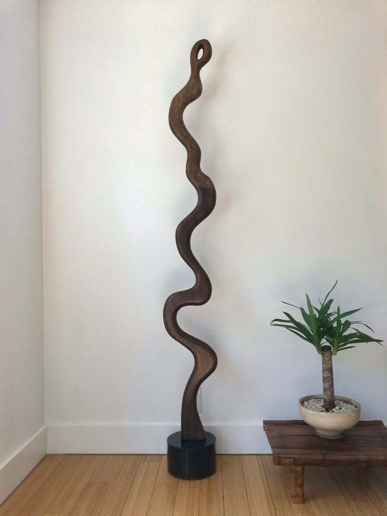 A nice scale decorative art object. It appears to be solid mahogany on a lacquered wood base, attached via steel post. (Not sure if the base is original but works well nonetheless).
