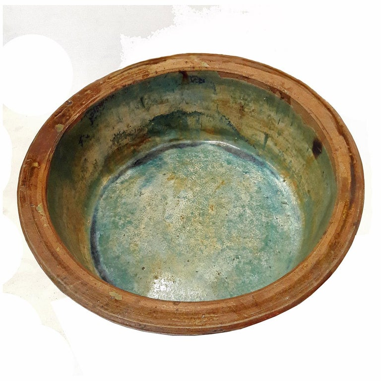 A tall and large ceramic bowl from Indonesia with brown ridged exterior and a green glazed interior, circa 1960.
