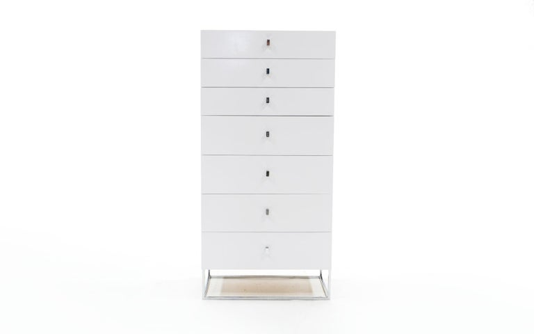 Roger Rougier white lacquered chest of seven drawers / dresser with chromed steel base and pulls. This piece has been repainted with only a few blemishes which are evident in the photos.