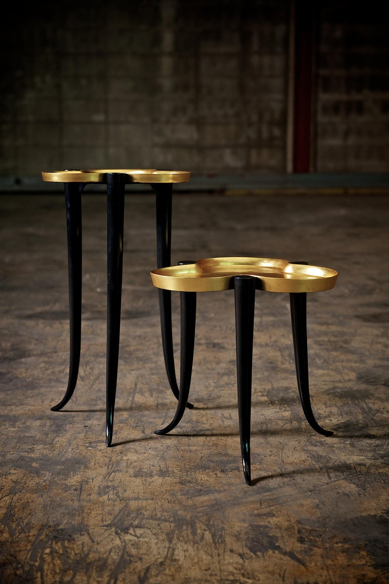 The Chime side table is composed of cast bronze legs with a gilt lacquer trey top. The Chime is available with either a silver leaf or gold leaf lacquer top. Custom sizes and finishes are available.