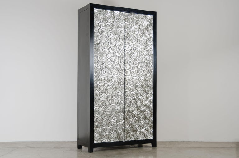 Tall Cloud Armoire White Bronze Hand Repousse Wood Limited Edition Each piece is individually crafted and is unique.  Repousse´ is the traditional art of hand-hammering decorative relief onto sheet metal. The technique originated around 800