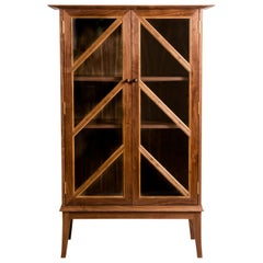 Tall Contemporary Walnut Cabinet with Glass Doors and Butternut Details