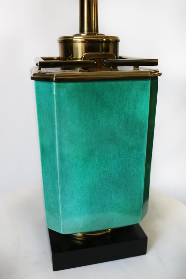 This turquoise and brass table lamp by Edwin Cole for Stiffel is in overall very good condition. Wear consistent with age and use. Beautiful aged brass hardware. Lamp shade included, circa 1950s, USA. Dimensions without the shade: D 9.5