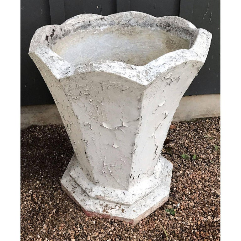 Heavy and tall French concrete planter in the Art Deco style. Painted white with scalloped top and octagonal base. Has been painted several times in the past, circa 1930.