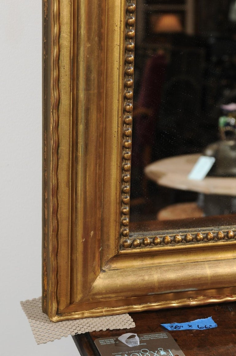 Tall French Louis-Philippe Style 19th Century Giltwood Mirror with Carved Crest For Sale 3