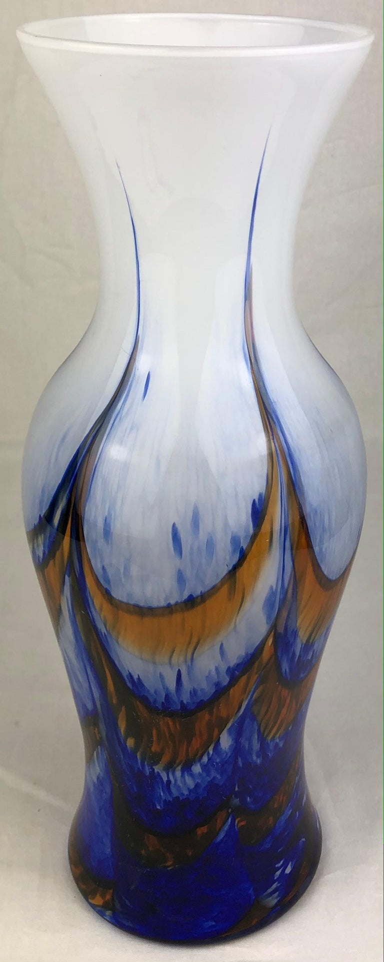 A white, blue and orange variegated tall art glass vase perfect as a center piece on a dining or side table. French Art Deco transition period, attributed to Schneider Glassworks. White background with beautiful blue and orange swirl motifs.