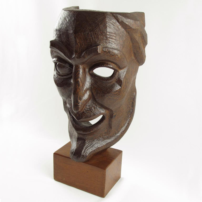 Stunning mid-20th century all hand carved and pierced wood mask sculpture. Palm wood with beautiful carving, extremely detailed and textured, featuring a grotesque character in the style of La Comedia Dell'Arte. Signed and dated on top. Inscription