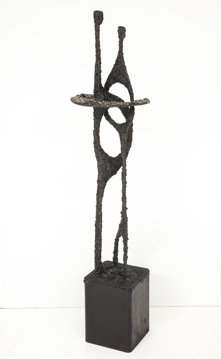 Brutalist abstract figural sculpture, titled