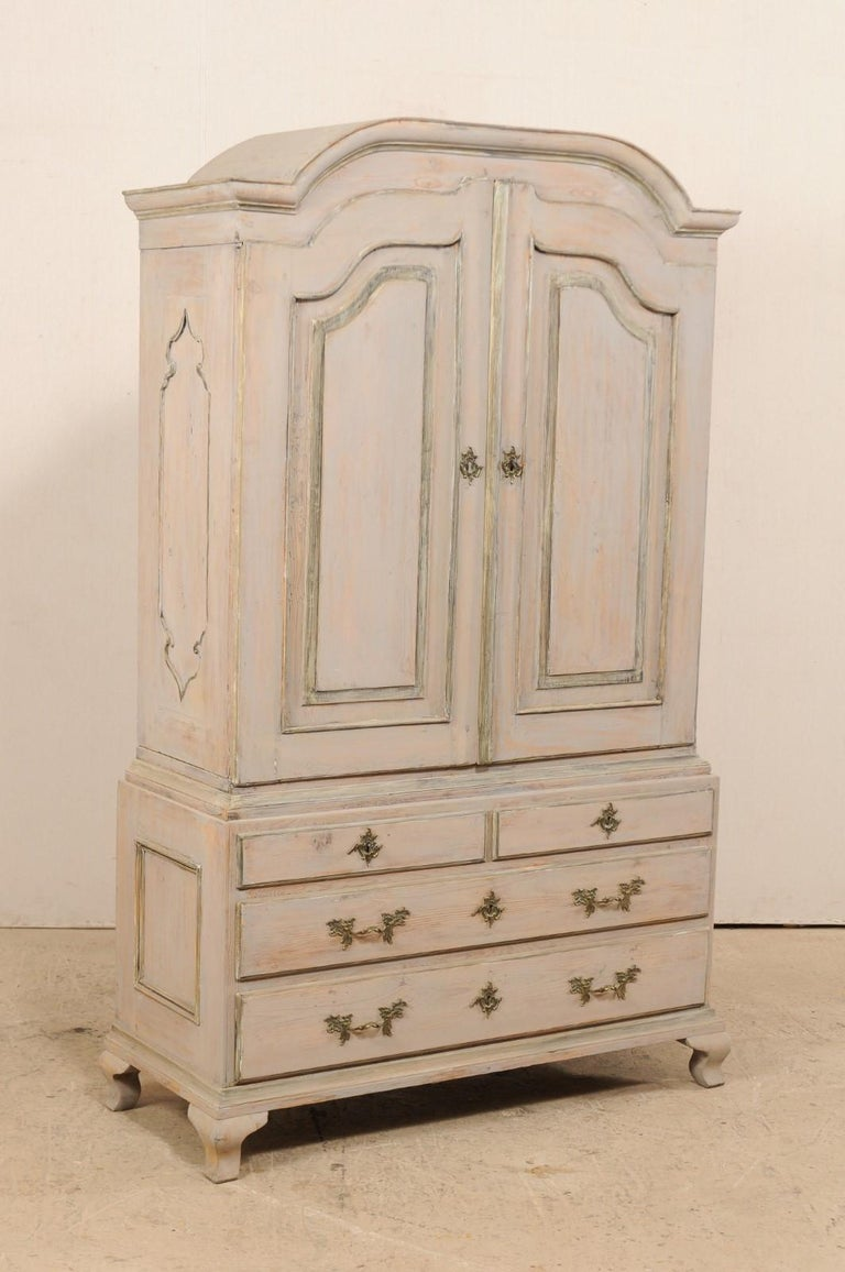 A beautiful Swedish late 18th century period Rococo painted wood cabinet. This spectacular antique cabinet from Sweden features and upper cabinet of two grand doors that open to reveal a spacious interior with three shelves and a full width drawer,