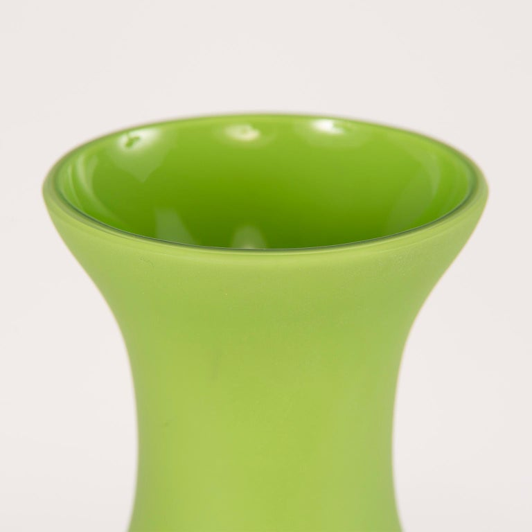 """Classic form cenedese Murano glass vase, circa 1970s. Matte finish spring green color and stands 12"""" high. Etched signature on underside of base. Excellent vintage condition with no flaws found."""