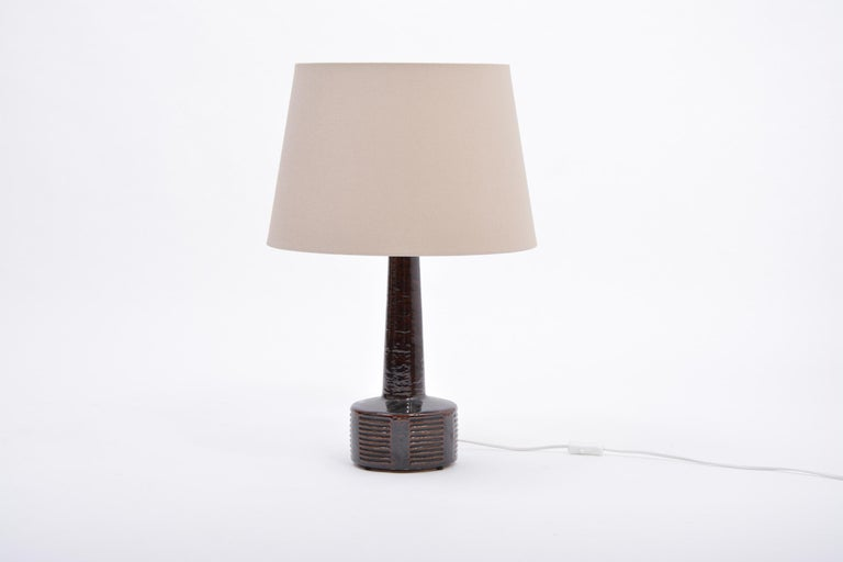 Tall Mid-Century Modern ceramic table lamp by Per Linnemann-Schmidt for Palshus  This tall was designed by Per Linnemann-Schmidt and produced in the 1960s by Palshus ceramic in Denmark. The lamp's base is made of chamotte stoneware with dark brown
