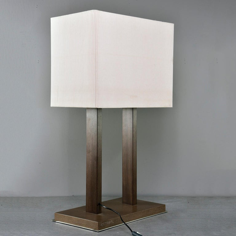 """Tall table lamp has a base of walnut layered over brushed steel with walnut supports and a tightly pleated rectangular shade, circa 1970s. Unknown maker. Found in Italy. New wiring for US electrical standards.  Measures: Shade only: 15.5"""" H x 20"""""""