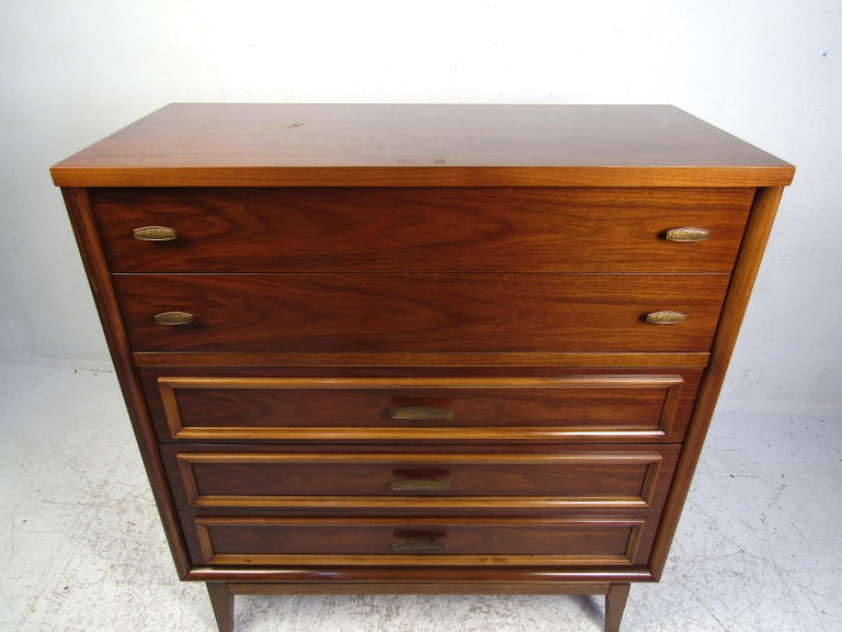 This elegant multi-drawer piece features elegant lines and a simplistic style. With clean edges and bold accents, this dresser will add substance to any space it is placed in. Perfect for any bedroom or guest room set up. Made from solid materials