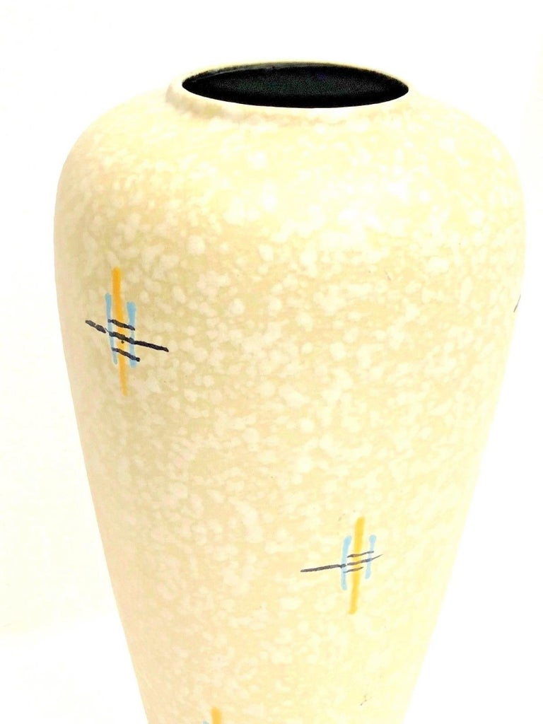 An amazing crack glazed ceramic Mid-Century Modern floor vase made in Germany, circa 1950s. This is a heavy floor vase but you can also use it as a umbrella stand. Vase is in very good condition with no chips, cracks, or flea bites. Made by
