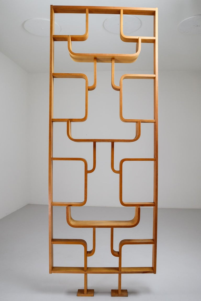 A unique 1960s piece of Czech design, part of a limited five year production. Can be used as a wall-mounted shelving unit or room divider. Square edges in blond color plywood and features geometric patterns. Designed by Ludvik Volak in the Czech