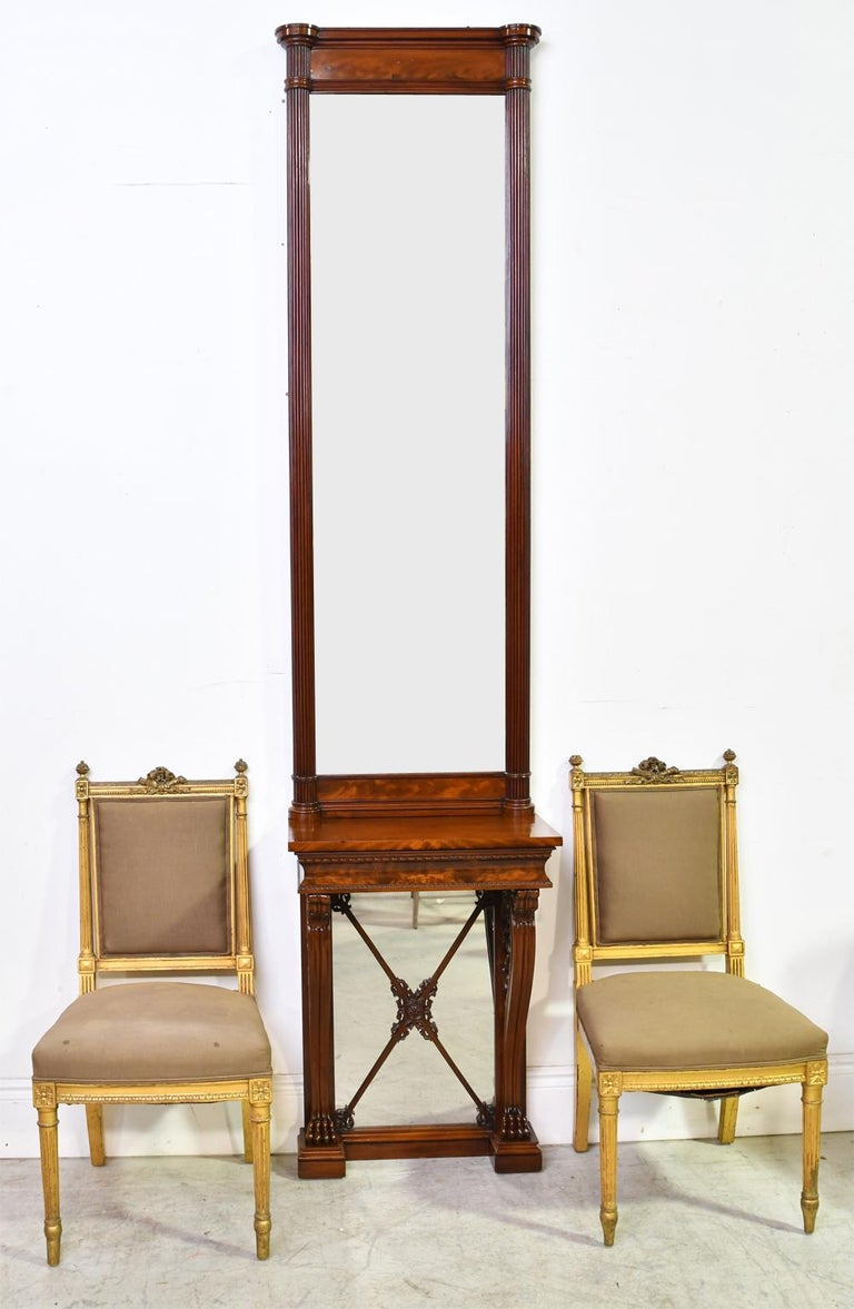 A narrow and tall Empire console and pier mirror in fine West Indies mahogany in the manner of well-known German-born Danish designer and architect Gustav Friedrich Hetsch (Stuttgart, 1788 - Copenhagen, 1864). Denmark, circa 1830. This