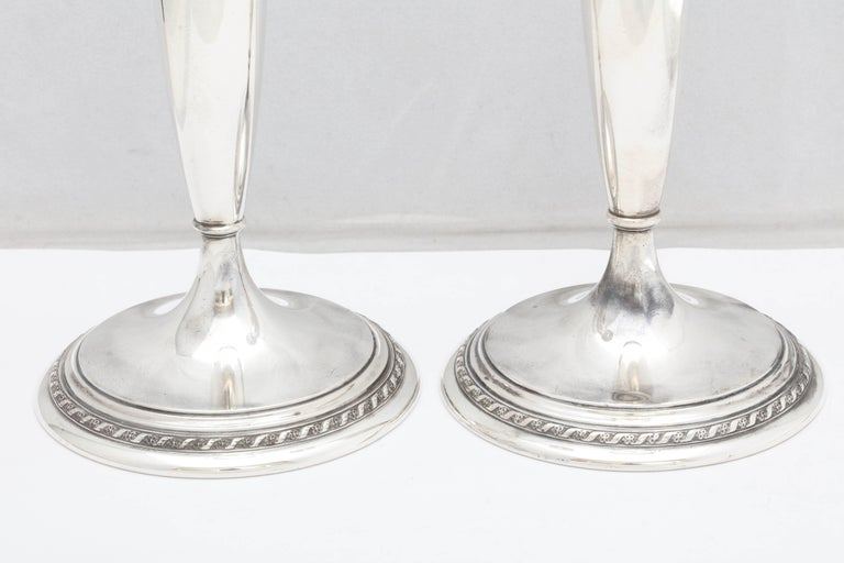 Tall pair of Art Deco, sterling silver candlesticks, Gorham Manufacturing Co., year hallmarked for 1924. Each candlestick measures 10 inches high x 4 inches in diameter across base. There are a few very minor dints (see photos) commensurate with age