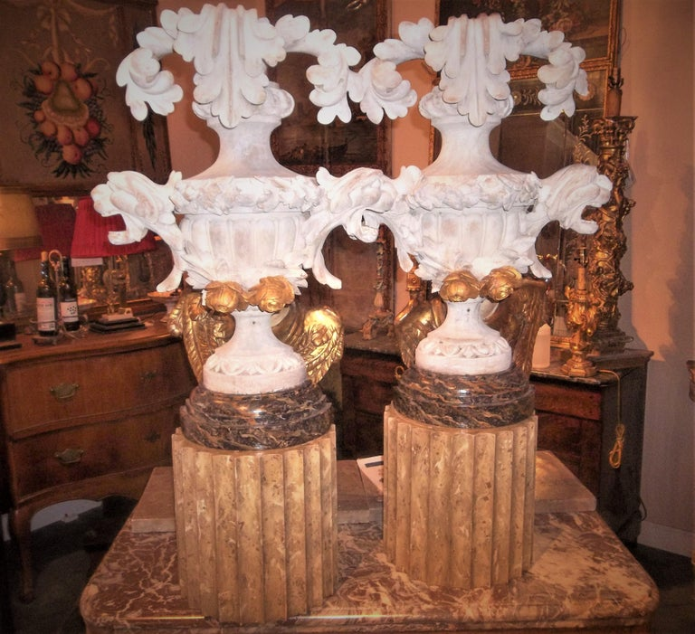 On black and gold faux marble bases. Possibly from an altar. Most likely gilded originally then stripped (traces of gesso and gilt) and white washed. Overall good condition but distressed finish from the original creation. 