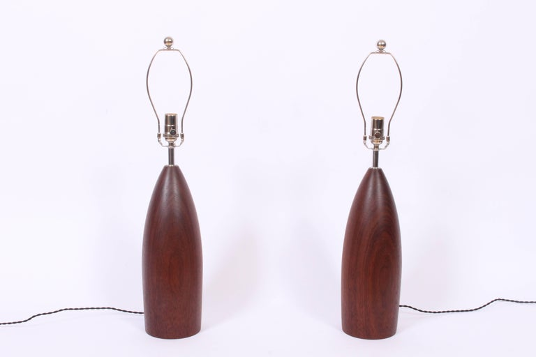 Large pair of Scandinavian Modern ESA attributed, deep brown tapered Dark Brown Teak Table Lamps. Featuring finely turned, smooth, bullet forms. 21 H to top of socket. Shades shown for display only (9.5 H x 12 D top x 13 D bottom). Timeless. Premium