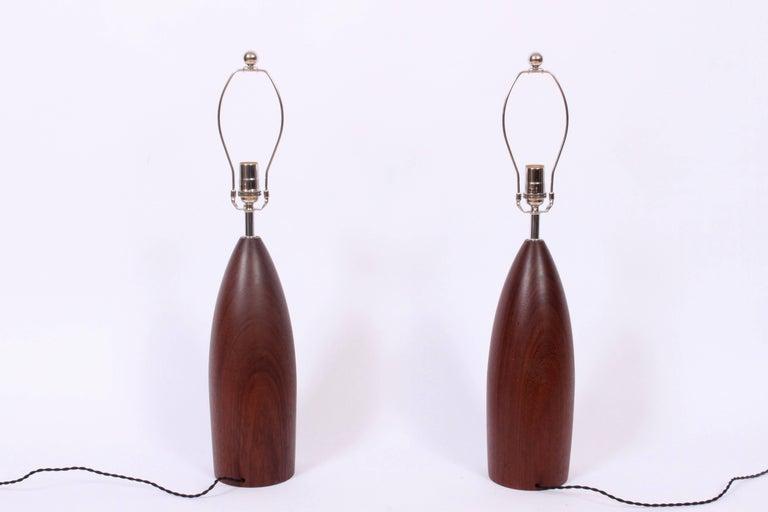 Scandinavian Modern Tall Pair of ESA Danish Modern Turned Solid Dark Teak Table Lamps, circa 1960 For Sale
