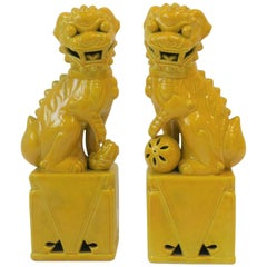 Pair of Tall Midcentury Yellow Foo Dogs or Lion Sculptures